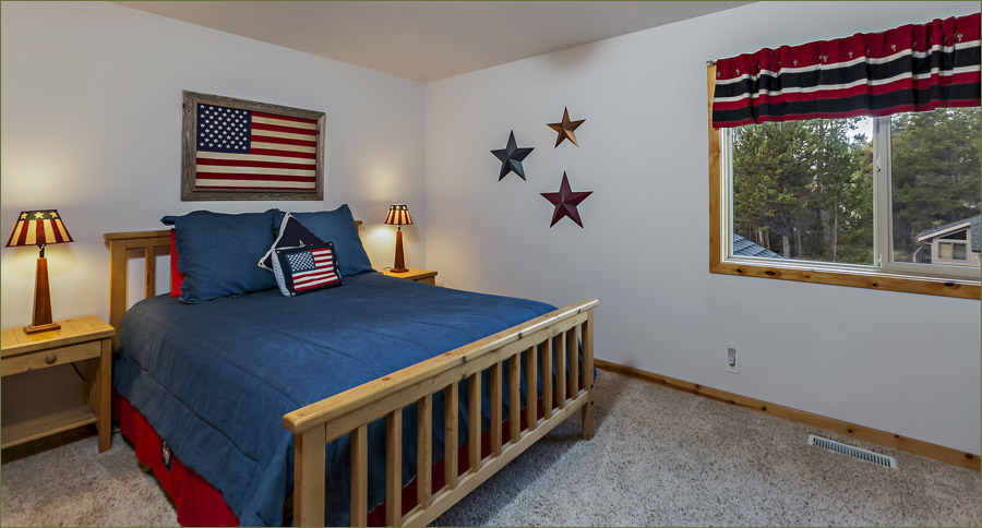Spacious queen sized guest room situated on the upper level.