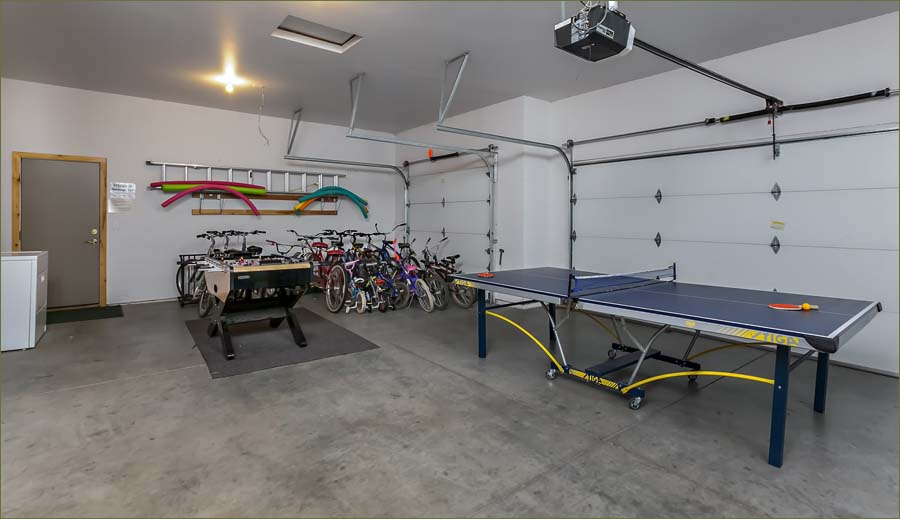 Snug garage with bikes, games and ping pong table.