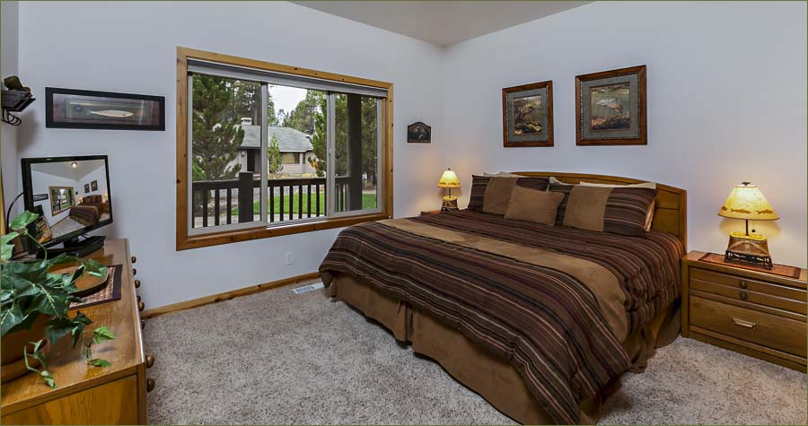 Master guestroom with private bathroom, flat screen TV and quality bedding.