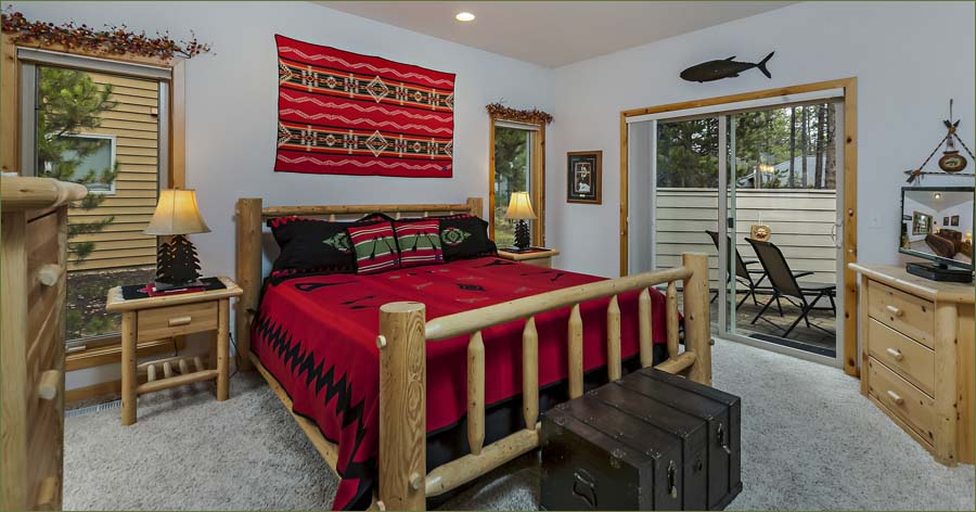 Large master bedroom with private bathroom and access to the private outdoor hot tub under the stars.